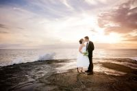 Bride and groom on the beach in Maui